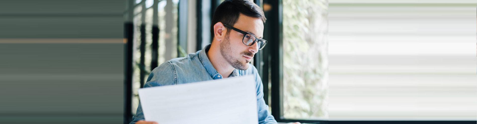 man looking at paperworks